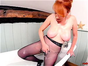 crimson hardcore frolicking with her vagina while in pantyhose