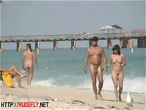 An extremely alluring naked beach hidden cam flick