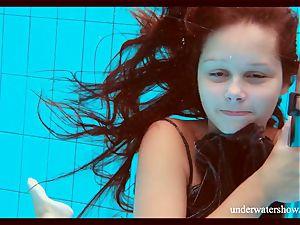 clean-shaved bombshell Nata Szilva is a mermaid