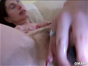 Mature grandmother enjoys to bang rock hard with fake penis