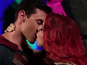 Britney Amber gargles off a kinky superhero