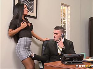 assistant Elicia Solis sits astride the chief on his desk